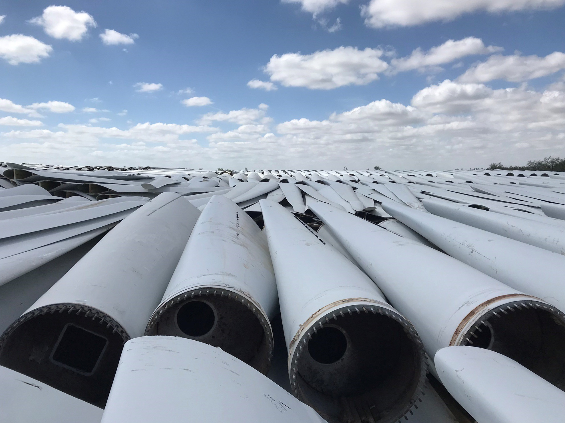 Photo of: Decommissioned wind turbine blades in a Global Fiberglass Solution staging yard in Sweetwater, Texas, U.S